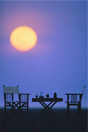 Table and Chairs with Drinks Outdoors at Dusk Stock Photo - Rights-Managed, Code: 873-06440226