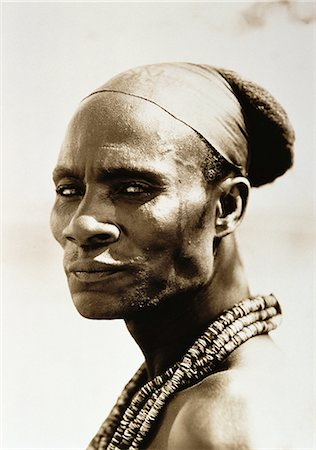 Portrait of Himba Man Wearing Beads around Neck, Namibia Stock Photo - Rights-Managed, Code: 873-06440385