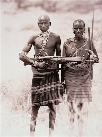 Portrait of Two Masai Men Holding Weapons Outdoors, Kenya Stock Photo - Rights-Managed, Code: 873-06440425