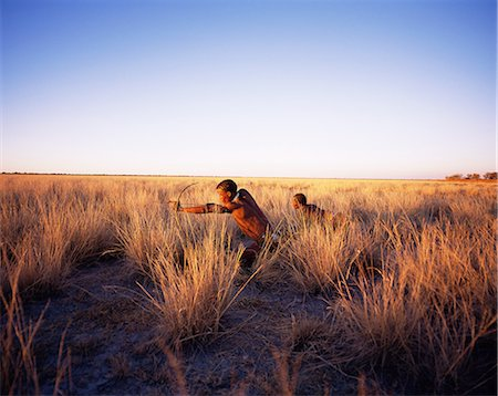Bushmen Hunting in Grassy Field Namibia, Africa Stock Photo - Rights-Managed, Code: 873-06440473