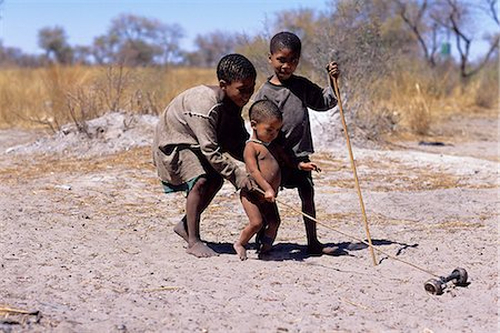 Bushman Children Playing with Toy Outdoors Namibia, Africa Stock Photo - Rights-Managed, Code: 873-06440553
