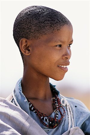 Portrait of Bushman Child Outdoors Namibia, Africa Stock Photo - Rights-Managed, Code: 873-06440564