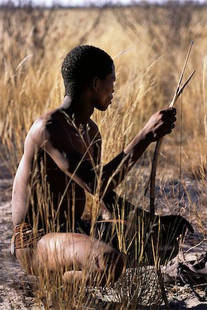 Bushman Hunter Sitting in Field Namibia, Africa Stock Photo - Rights-Managed, Code: 873-06440568