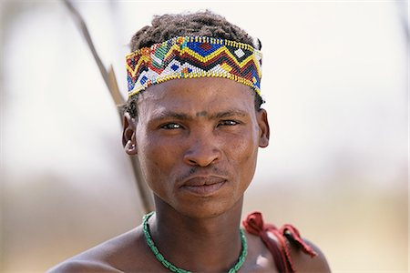 Portrait of Bushman in Traditional Headdress Namibia, Africa Stock Photo - Rights-Managed, Code: 873-06440562