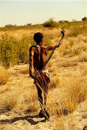 Bushman Walking Through Kalahari Desert, Botswana, Africa Stock Photo - Rights-Managed, Code: 873-06440686