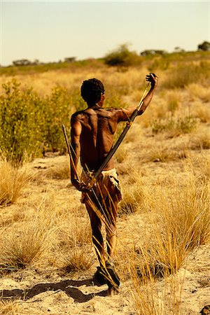 Bushman Walking Through Kalahari Desert, Botswana, Africa Stock Photo - Rights-Managed, Code: 873-06440686