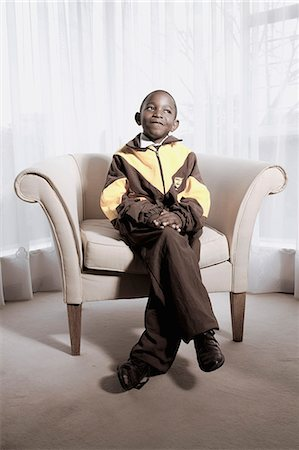 Boy Sitting in Chair Stock Photo - Rights-Managed, Code: 873-06440811