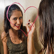 Woman Writing on Mirror with Lipstick