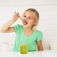 Little Girl Eating Honey