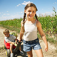 Girl and Boy with Corn and Wagon