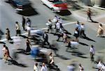 Blurred View of People Crossing Street