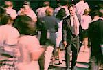 Businessman in Crowd