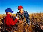 Farmer and Son in Field