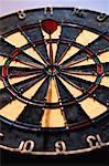 Close-Up of Dart in Bull's-Eye on Dartboard