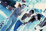 Three Women Walking on Street Laughing