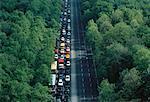 Aerial View of Traffic Jam on Road through Trees Berlin, Germany