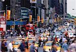 People Walking in Rush Hour Traffic on Street New York, New York, USA