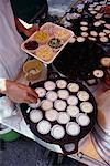 Close-Up of Person Preparing Food On Tray Bangkok, Thailand