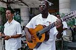 Man Playing Guitar in Outdoor Cafe, Havana, Cuba