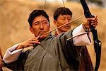 Men in Archery Contest at Gasello Wangdue Phodrang Valley, Bhutan