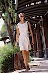 Woman Walking Outdoors, Carrying Shopping Bag