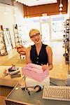 Portrait of Female Sales Person In Shoe Store