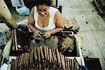 Woman Rolling Cigars in Cuba