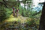 Couple Cycling through Rockies British Columbia, Canada