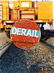 Derail Sign on Train Tracks