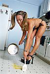 Woman in Bikini Cleaning up Broken Egg
