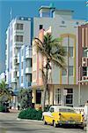 United States, Florida, Miami Beach, Ocean drive, classic car by Art Deco buildings