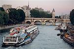France, Paris, Riverbus passing by the Pont-Neuf Bridge