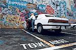 United States, California, San Francisco, car parked near graffiti