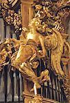 Italy, Rome, Chiesa Nueva, golden angel on organ