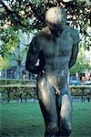 Norway, Bergen, bronze sculpture at dusk