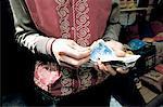 Turkey, Istanbul, Grand Bazaar, merchant counting his money