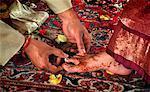 Groom Placing Ring on Bride's Toe