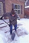 Senior Shovelling Snow