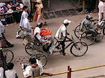 People Biking by Market Varanasi, India