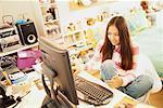 Girl Using Computer in Bedroom