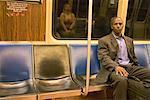Businessman Sitting in Subway Car