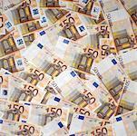 an array of fifty euro bills