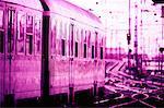 toned side profile of a train moving on railroad tracks