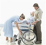 female nurse adjusting a wheel chair