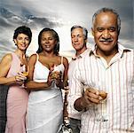 Portrait of two elderly couples holding wine glasses