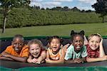 Portrait of Children Lying On Trampoline