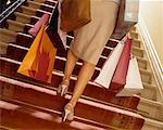 Woman Climbing Stairs, Carrying Shopping Bags