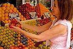 Woman Buying Fruits