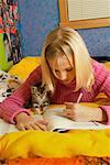 Teenage Girl With Kitten, Doing Homework, British Columbia, Canada