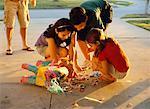 Kids Grabbing Candy From Broken Pinata